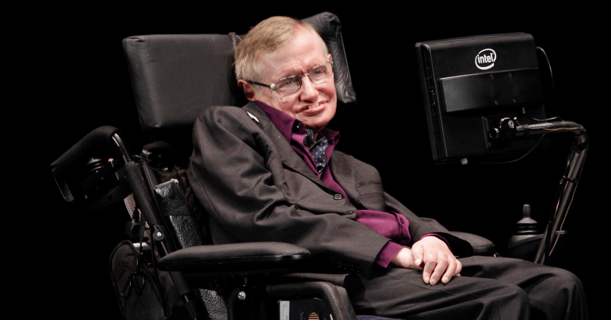 Scientist Stephen Hawking shown in his wheelchair using his computer to type and talk