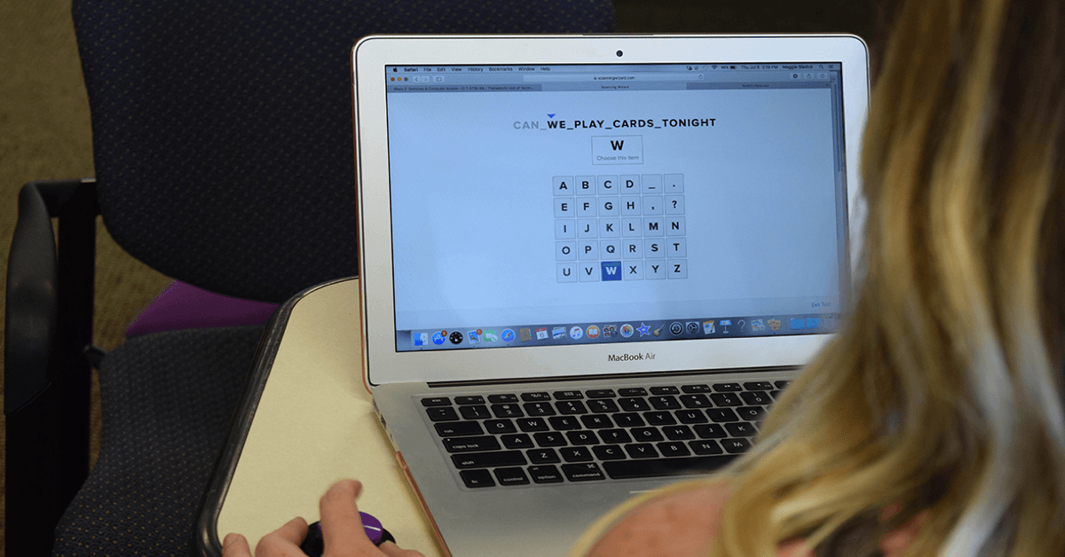 Occupational therapy student using Scanning Wizard, showing a grid of letter items on computer screen