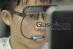 the GlassOuse assistive device worn like glasses on a user's face
