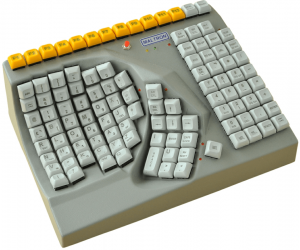 Picture of the Maltron left-hand keyboad, showing curved key areas for fingers and thumb, and 2 flat key areas for function keys and other characters.