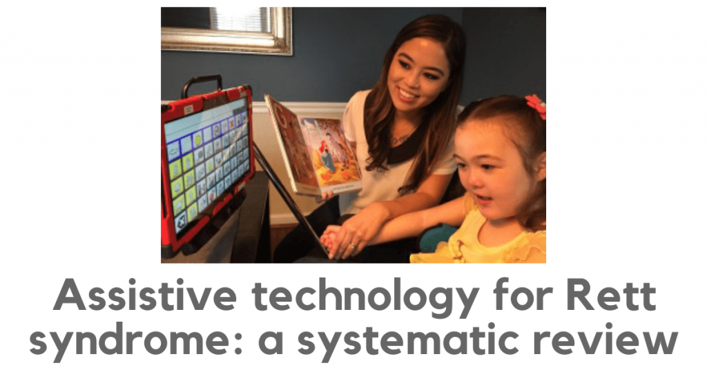 Assistive technology for Rett syndrome: a systematic review. Photo shows a young girl using a computer-based AAC system. An adult is alongside her, holding her hand.